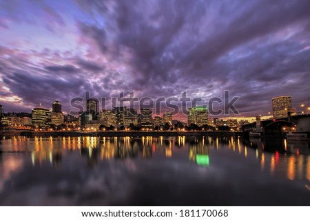 Portland Oregon Downtown Waterfront City Skyline with Reflection on Willamette River After Sunset - stock photo