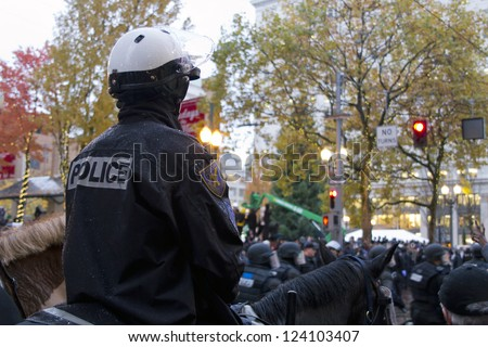 PORTLAND, OREGON - NOV 17: Mounted Police Watching over protestors in Downtown Portland, Oregon during a Occupy Portland protest on the first anniversary of Occupy Wall Street November 17, 2011