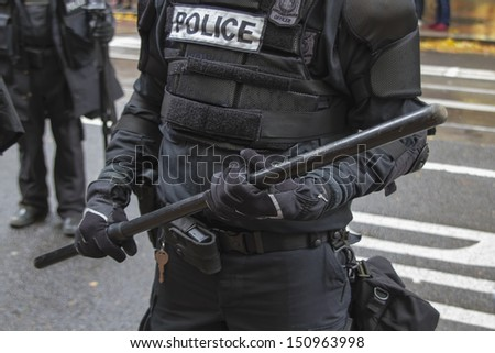 PORTLAND, OREGON - NOV 17: Police in Riot Gear Closeup in Downtown Portland, Oregon during a Occupy Portland protest on the first anniversary of Occupy Wall Street November 17, 2011 - stock photo