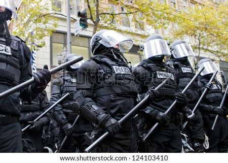 PORTLAND, OREGON - NOV 17: Police in Riot Gear Holding the Line in Downtown Portland, Oregon during a Occupy Portland protest on the first anniversary of Occupy Wall Street November 17, 2011 - stock photo