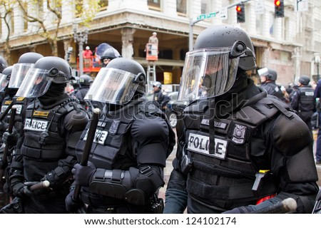PORTLAND, OREGON - NOV 17: Police in Riot Gear in Downtown Portland, Oregon during a Occupy Portland protest on the first anniversary of Occupy Wall Street November 17, 2011 - stock photo