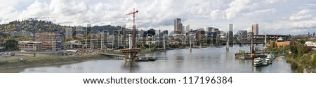 Portland Oregon Skyline Along Willamette River with Bridges Panorama - stock photo