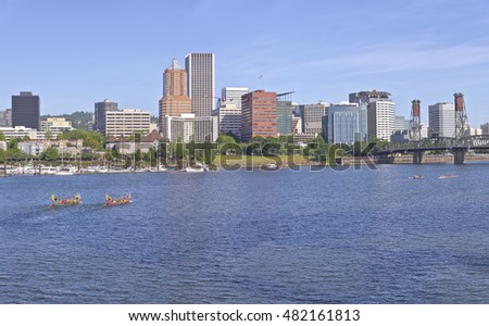 Portland Oregon skyline and dragon boats rowing in morning light.