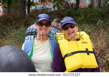 Portland, Oregon, USA - July 26, 2015: The Big Float 2015 - Floaters stop to get a photo during the procession that leads to the water to float back down the Willamette River