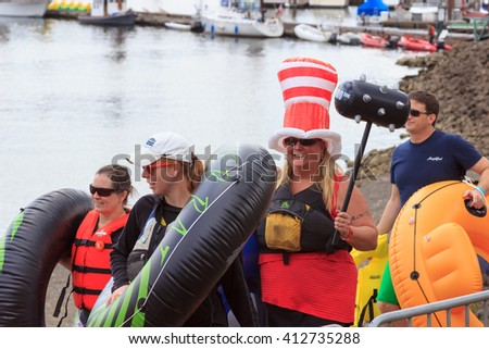 Portland, Oregon, USA - July 26, 2015: The Big Float 2015 - The Big Float attendees parade down the waterfront to begin floating down the Willamette River