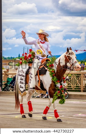Portland, Oregon, USA - June 11, 2016: Coos County Fair & Rodeo, Queen Charlie Mae Yates in the Grand Floral Parade during Portland Rose Festival 2016.