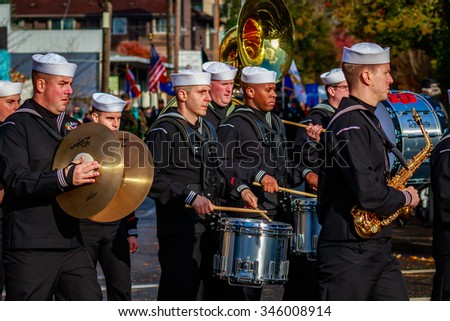 Portland, Oregon, USA - November 11, 2015: People march in the annual Ross Hollywood Chapel Veterans Day Parade, in northeast Portland.