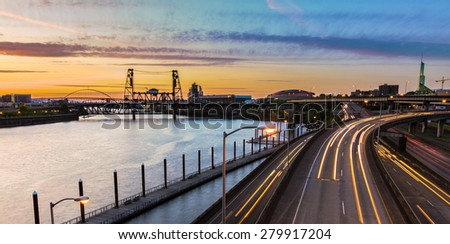 Portland, Oregon view of the Steel Bridge with light reflections on the Willamette River - stock photo