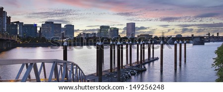 Portland Oregon Waterfront Skyline by the Boat Dock Along Willamette River at Sunset Panorama - stock photo