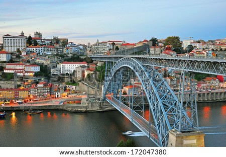 Porto bridge and panorama of historical centre of city on sunset