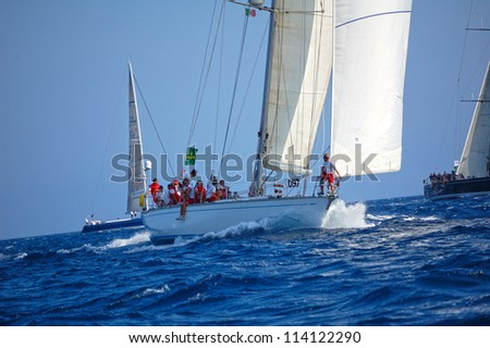 PORTO CERVO, ITALY - SEPTEMBER 12: team unidentified compete in the Rolex Swan Cup boat race on September 12, 2012 in Porto Cervo, Italy. - stock photo