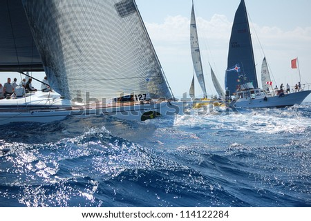 PORTO CERVO, ITALY - SEPTEMBER 12: teams unidentified compete in the Rolex Swan Cup boat race on September 12, 2012 in Porto Cervo, Italy. - stock photo