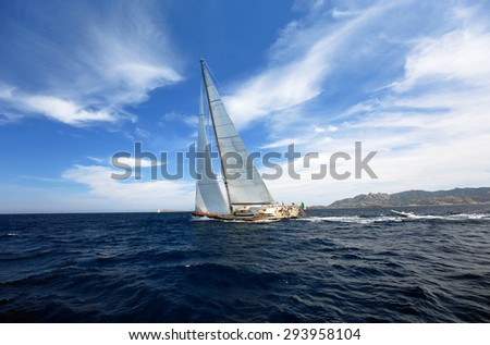 PORTO CERVO, SARDINIA, ITALY - JULY 01, 2015: BEAUTIFUL Yacht at full spead, training for boat race (team unidentified)
