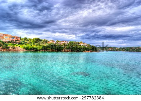 Porto Cervo shoreline on a cloudy day. Processed for hdr tone mapping effect - stock photo