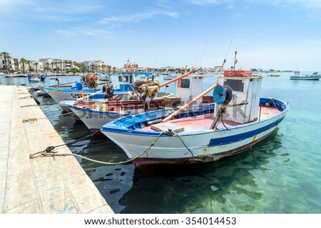 PORTO CESAREO, ITALY - MAY 17, 2015: day view of boats and coastline in Porto Cesareo, Italy. Apulia beaches are among the finest in the whole country of Italy.