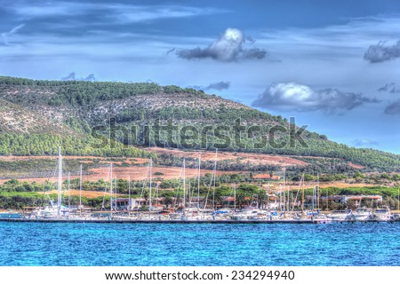 Porto Conte harbor on a cloudy day. Processed for hdr tone mapping effect. - stock photo
