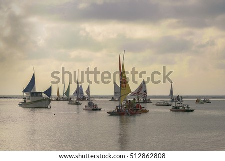PORTO GALINHAS, BRAZIL, JANUARY - 2016 - Group of boats at sea in Porto Galinhas, Pernambuco, Brazil