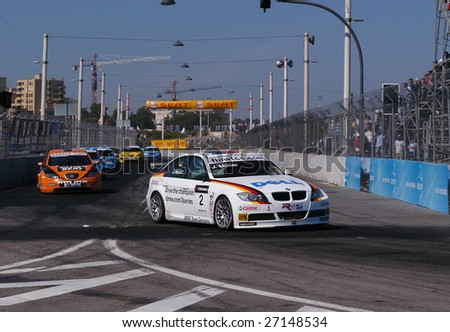 PORTO - JULY 8: J. Muller of Germany in his BMW participates in the FIA WORLD TOURING CAR CHAMPIONSHIP (WTCC) on July 8, 2007 in Porto, Portugal. Andy Priaulx emerged 2007 WTCC Drivers' Champion. - stock photo