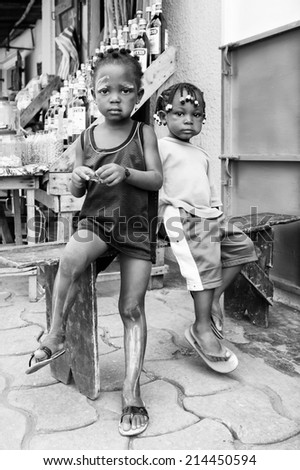 PORTO-NOVO, BENIN - MAR 9, 2012: Unidentified Beninese children in the street. People of Benin suffer of poverty due to the difficult economic situation