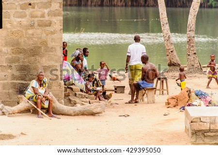 PORTO-NOVO, BENIN - MAR 9, 2012: Unidentified Beninese people at the local market. Children of Benin suffer of poverty due to the difficult economic situation