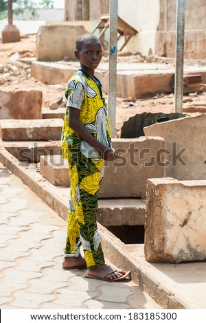 PORTO-NOVO, BENIN - MAR 9, 2012: Unidentified Beninese woman at the local market. People of Benin suffer of poverty due to the difficult economic situation