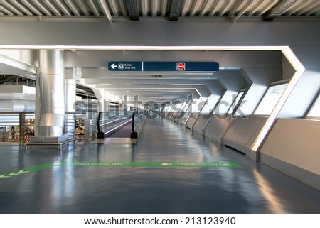 PORTO, PORTUGAL - AUGUST 3, 2014: interior of Francisco Sa Carneiro Airport. The airport is about 10 km from the center of the city of Porto, and it's named in memories of Portuguese Prime Minister - stock photo
