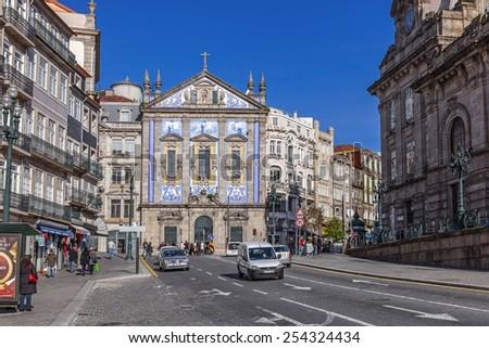 Porto, Portugal. December 29, 2014: Santo Antonio dos Congregados Church in Almeida Garrett Square. Baroque architecture decorated with the typical Portuguese blue tiles. Unesco World Heritage Site - stock photo