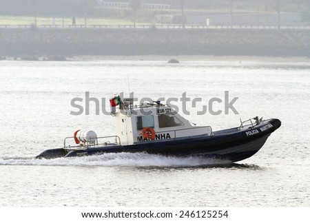Porto, Portugal - January 2, 2013: Police maritime boat during normal surveillance on Douro River in a foggy morning - stock photo