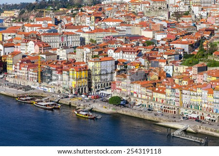 Porto, Portugal. January 5, 2015: The typical colorful buildings of the Ribeira District and the Douro River in the city of Porto, Portugal. Unesco World Heritage.