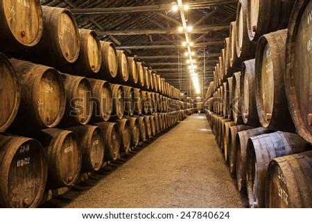 PORTO, PORTUGAL - JULY 01: Barrels with Porto Wine in the wine cellar on July 01, 2014 in Porto, Portugal  - stock photo