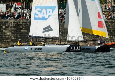 PORTO, PORTUGAL - JULY 07: SAP Extreme Sailing Team compete in the Extreme Sailing Series boat race on july 07, 2012 in Porto, Portugal. - stock photo