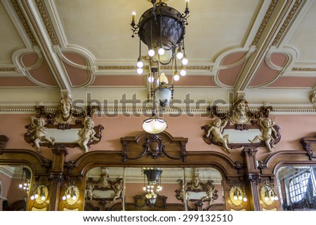 PORTO, PORTUGAL - JULY 04, 2015: The Majestic, historical coffee interior detail, first opened on December 17, 1921, it´s located in Santa Catarina, On July 04, 2015 in Porto, Portugal. - stock photo