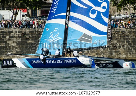 PORTO, PORTUGAL - JULY 07: The Wave - Muscat compete in the Extreme Sailing Series boat race on july 07, 2012 in Porto, Portugal.