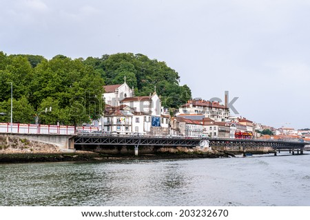 PORTO, PORTUGAL - JUN 21, 2014: Beautiful houses on the coast of the River Douro in Porto, Portugal. View from the River Douro, one of the major rivers of the Iberian Peninsula (2157 m)