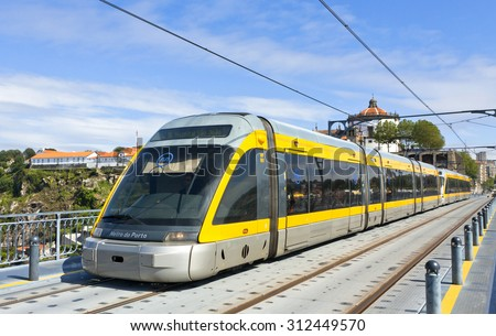 PORTO, PORTUGAL - JUNE 17, 2013: Light rail train of Metro do Porto, part of the public transport system of Porto city. First line of the system was opened in 2002 - stock photo