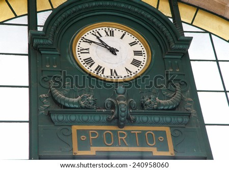 PORTO, PORTUGAL - JUNE 4, 2014: Old station clock in the famous Sao Bento Railway Station at the Almeida Garret Square in Porto, Portugal. - stock photo