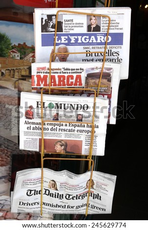 PORTO, PORTUGAL - JUNE 1, 2012: Retail sale of newspapers - stock photo