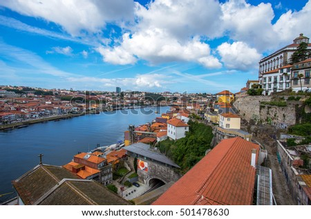 PORTO, PORTUGAL June 17, 2016 - View from the iconic Dom Luis I bridge crossing the Douro River, and the historical Ribeira and Se District in the city of Porto, Portugal. Unesco World Heritage Site.