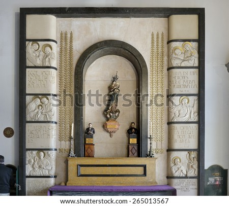Porto, Portugal - March 23, 2015: Niche of the church Santo Antonio dos Congregados with the images of Our Lady Help of Christians with baby Jesus in her arms, Saint Dominic Savio and St. John Bosco.