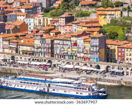 PORTO, PORTUGAL - MARCH 16, 2015: The Douro river runs along Porto ribeira, Portugal.