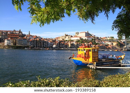 PORTO, PORTUGAL - 2014 MAY 2: Tourists go for a boat ride to see the sights of the Douro, Ribeira do Porto, Portugal 2 May 2014  - stock photo