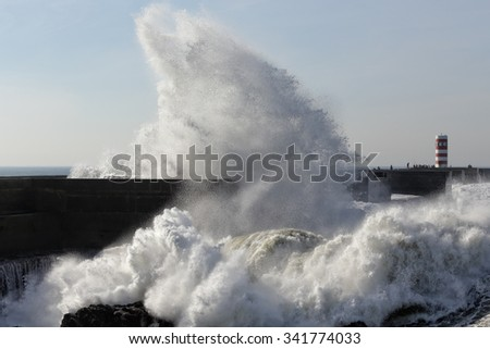 Porto, Portugal - November 11, 2015: Huge wave rising through the new pier at the mouth of the Douro river, a good but dangerous fishing point