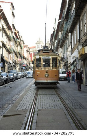 PORTO-PORTUGAL NOVEMBER 1, 2015: In 1872, the tram service opened the first mule tram line in Porto. The service used only three trams at this day.  Tramways are popular with the tourists.