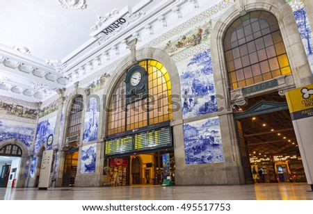 PORTO, PORTUGAL - OCTOBER 6, 2015: Painted ceramic tileworks (Azulejos) on the walls of Main hall of Sao Bento Railway Station in Porto. Station building is a popular tourist attraction of Europe