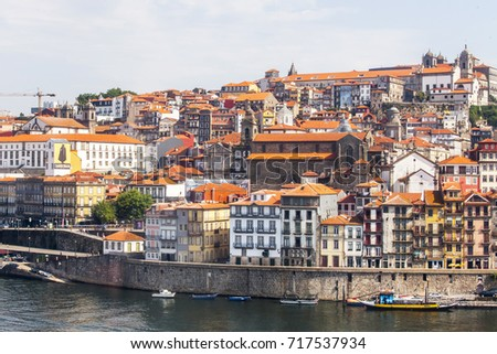 PORTO, PORTUGAL, on June 15, 2017. Summer day. The sun lights red roofs of in downtown on the river bank of Douro.