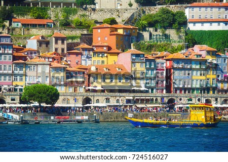 PORTO, PORTUGAL - SEPTEMBER 5, 2017: Douro river and Ribeira river walk with tourists and boats view