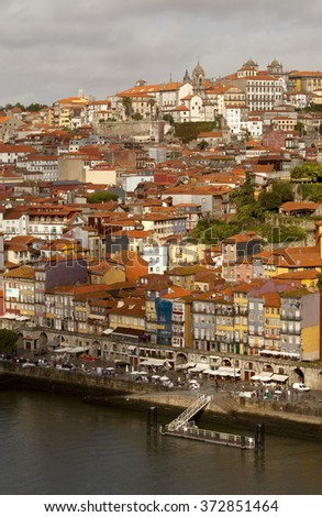 Porto runs down a Steep River Bank. The river Douro has cut a deep river path through the landscape where Porto the historical town has been built. Porto cascades down these steep river banks. - stock photo