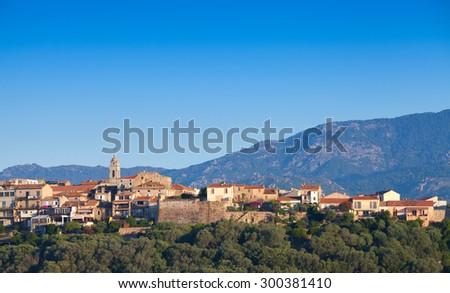 Porto-Vecchio cityscape under bright blue sky, Corsica island, France - stock photo