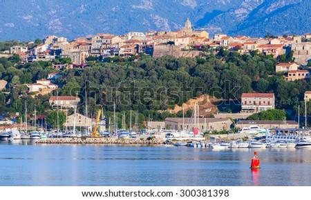 Porto-Vecchio, coastal cityscape with yachts and boats, Corsica island, France - stock photo