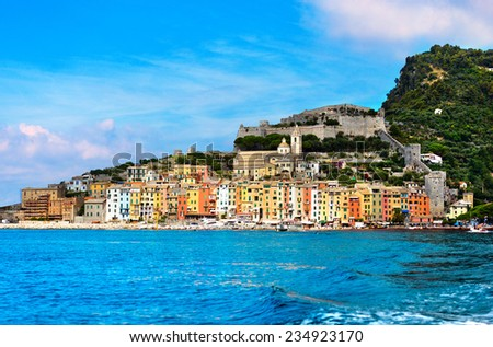 Portovenere - Liguria Italy / View of Portovenere or Porto Venere (UNESCO world heritage site), seen from the Island of Palmaria. In the foreground cultivation of mussels. La Spezia, Liguria, Italy - stock photo